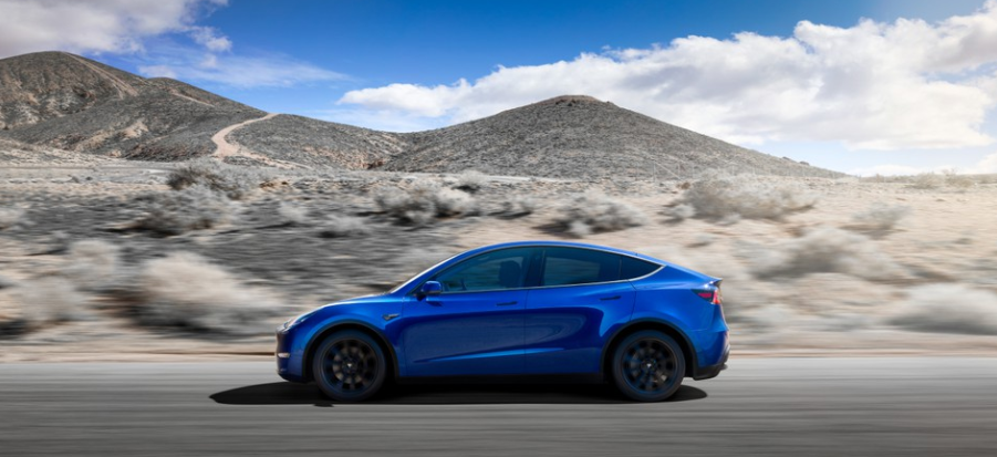 Tesla Model Y in blue with black wheels